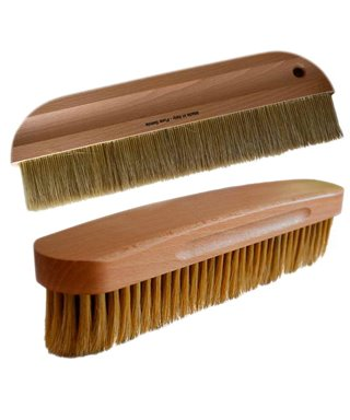 BRUSH THE WALLPAPER WITH WOODEN HANDLE